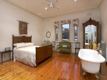 Classic bedroom design idea with floorboards & sash windows using brown colours - Bedroom photo 1310302