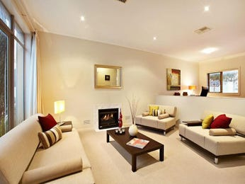 Open plan living room using brown colours with carpet & fireplace - Living Area photo 317297