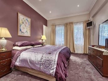 Romantic bedroom design idea with carpet & sash windows using beige colours - Bedroom photo 1076732