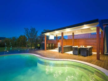 Freeform pool design using tiles with decking & decorative lighting - Pool photo 1567590