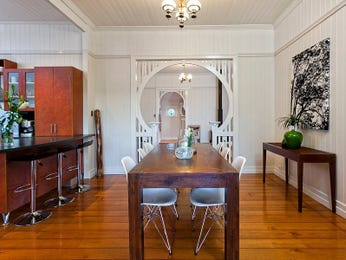 Classic dining room idea with floorboards & mantelpiece - Dining Room Photo 1226424