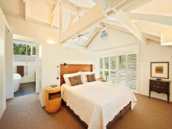 Classic bedroom design idea with carpet & exposed eaves using brown colours - Bedroom photo 917113
