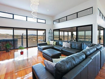 Open plan living room using blue colours with floorboards & floor-to-ceiling windows - Living Area photo 6889161