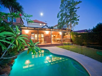 Freeform pool design using brick with glass balustrade & decorative lighting - Pool photo 1092208