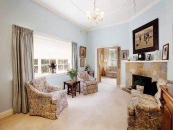 Open plan living room using cream colours with carpet & mantelpiece - Living Area photo 410964