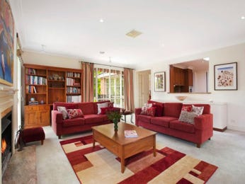 Open plan living room using red colours with carpet & fireplace - Living Area photo 1042650