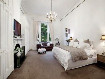 Retro bedroom design idea with hardwood & built-in wardrobe using brown colours - Bedroom photo 1094375