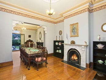 Classic dining room idea with floorboards & fireplace - Dining Room Photo 397970