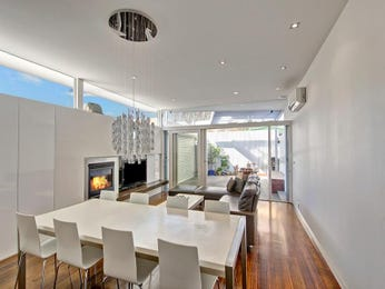 Modern dining room idea with floorboards & fireplace - Dining Room Photo 1942213