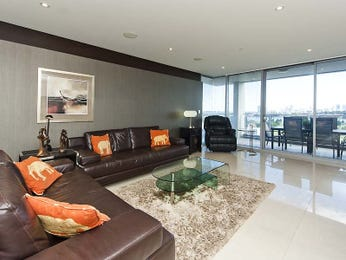 Open plan living room using brown colours with leather & floor-to-ceiling windows - Living Area photo 8228989