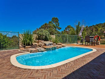 Freeform pool design using natural stone with outdoor dining & outdoor furniture setting - Pool photo 1574276