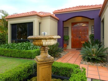 Tiles modern house exterior with portico & fountain - House Facade photo 694139