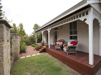 Landscaped garden design using brick with deck & outdoor furniture setting - Gardens photo 320704