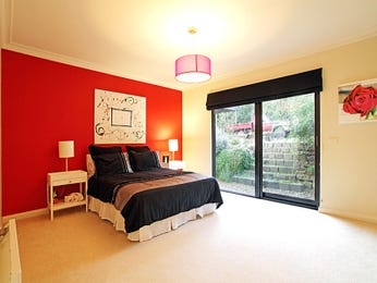 Bedroom ideas with sliding doors and feature wall in red for Red cream bedroom designs