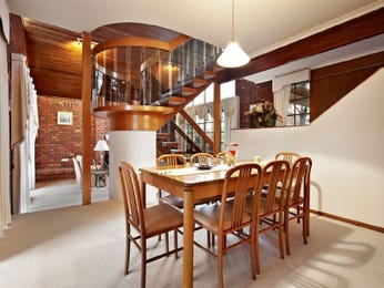Modern dining room idea with exposed brick & staircase - Dining Room Photo 1438868