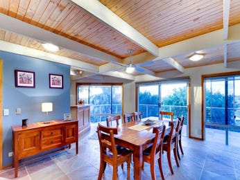 Country dining room idea with hardwood & exposed eaves - Dining Room Photo 1317577