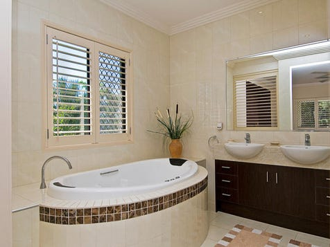 Shutters and rounded bath