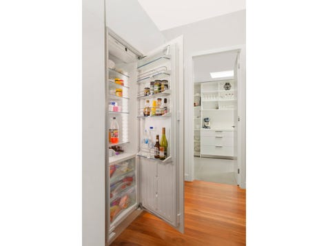 MODERN MAGNIFICENCE Clever fridge integration incorporated in kitchen design, minimalistic in kitchen.