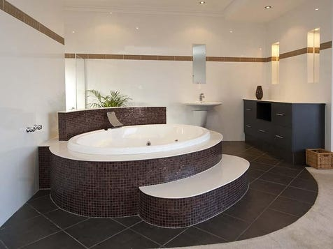 Layered bath with mosaic tiles
