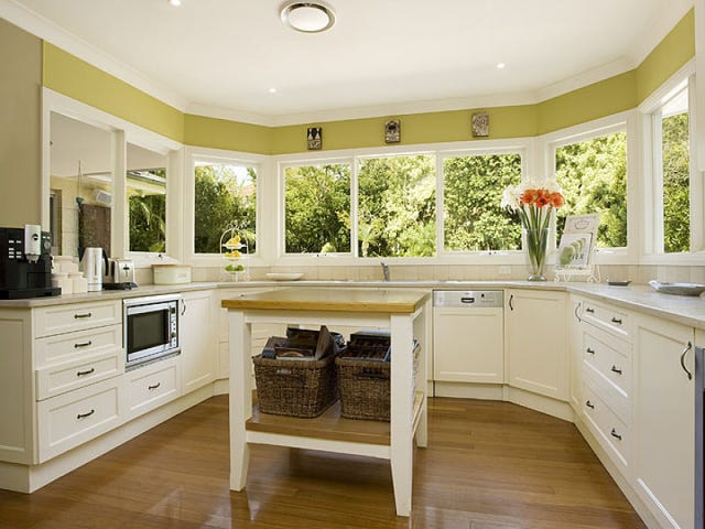 Always loved the classic kitchen. Great use of space using the wrap around windows and clever choice of paint colour bringing the outside in.
