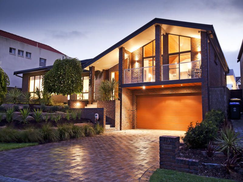 Brick modern house exterior with bay windows & decorative lighting ...