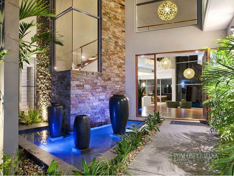 Tropical garden design using stone with fish pond