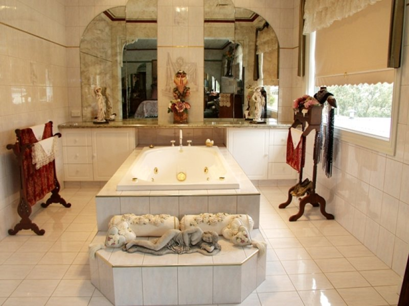 classic bathroom design with spa bath using tiles