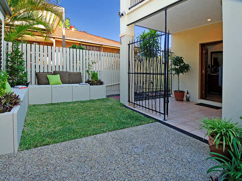 garden design with photo of a low maintenance garden design from a real australian with rock