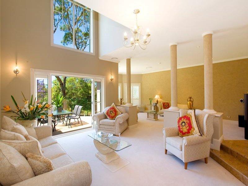 Split Level Living Room Using Neutral Colours With Tiles