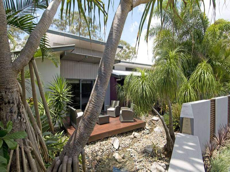 landscaped garden design using pebbles with verandah  u0026 outdoor furniture setting
