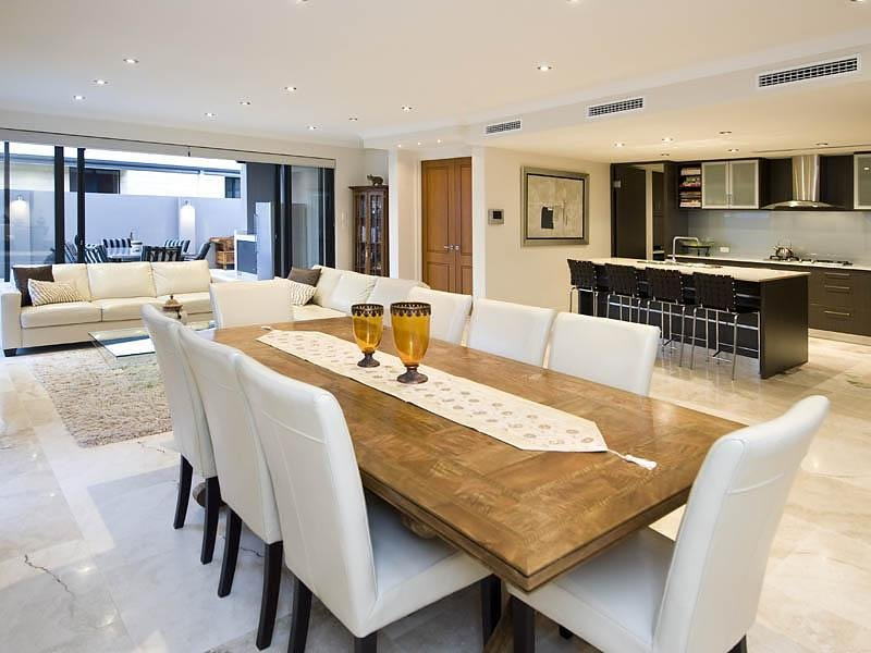 Modern dining room idea with hardwood & french doors