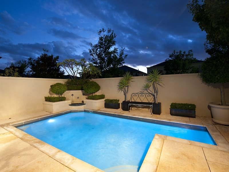 Swim spa pool design using stone with bbq area ground for Swimming pool area