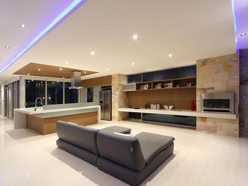 Split Level Living Room Using Beige Colours With Laminate