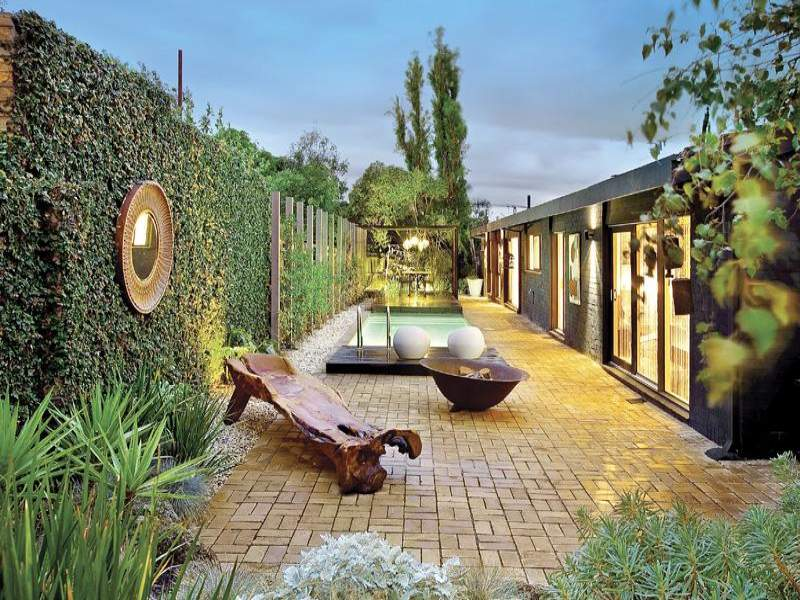 garden design using slate with pool outdoor furniture setting
