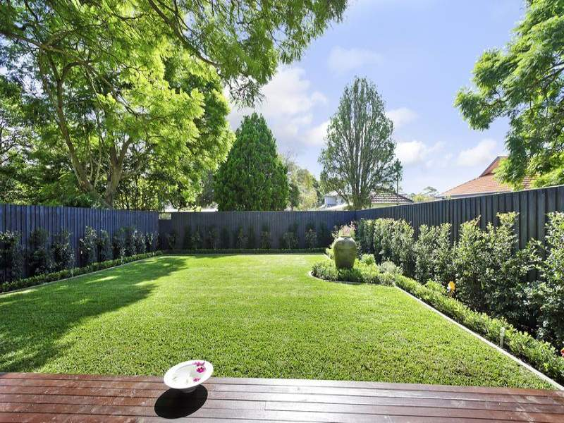 Landscaped garden design using woodchip with gazebo for Backyard design ideas australia