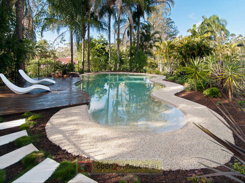 Australian native garden design using grass with pool for Family garden pool