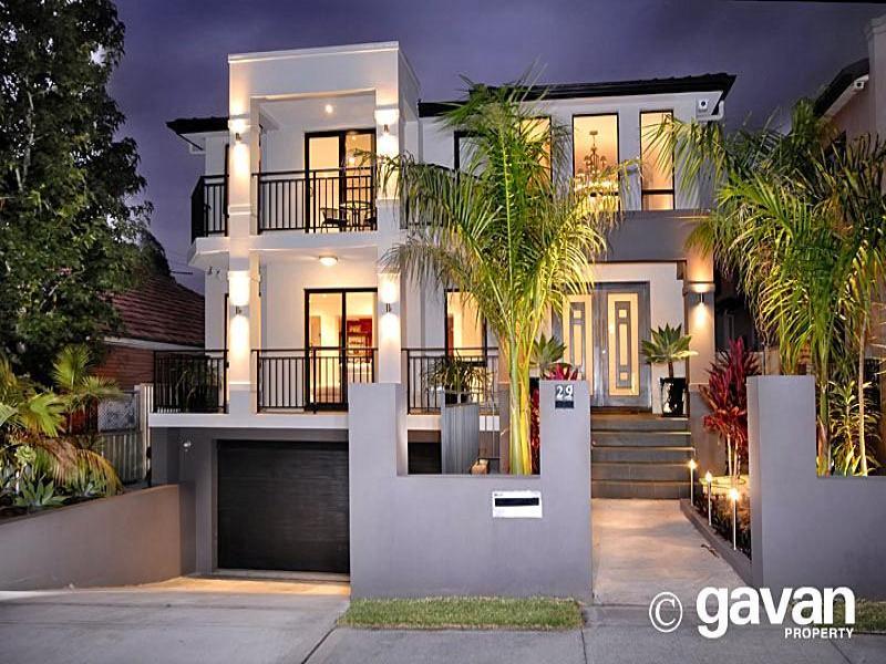 Concrete modern house exterior with balcony decorative for Small house facade ideas