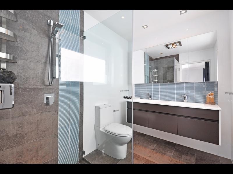 Asian Inspired Bathroom Design With Bi Fold Windows Using Ceramic