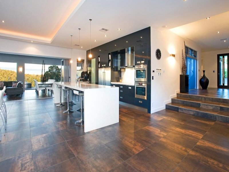 Modern open plan kitchen design using tiles kitchen for Modern open plan houses