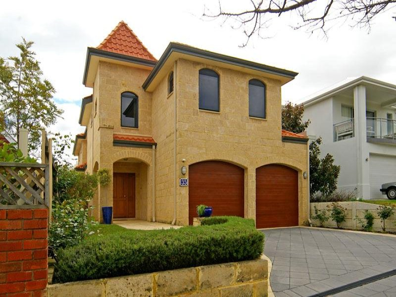 Sandstone modern house exterior with brick fence hedging for Exterior house facades