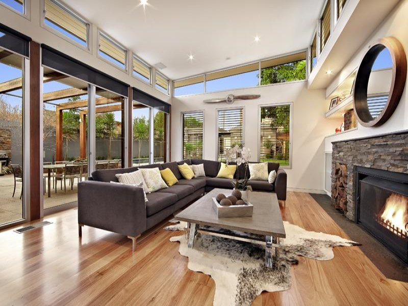 Open plan living room using beige colours with hardwood for Living area design ideas