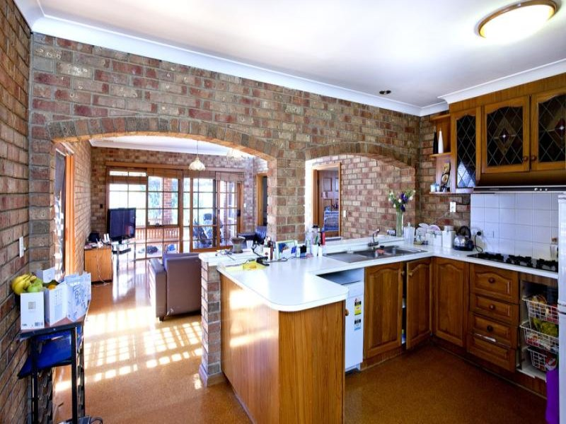 Country kitchen living kitchen design using exposed brick for Country living kitchen designs