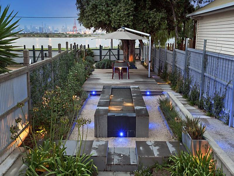 modern garden design using stone with orchard  u0026 decorative lighting