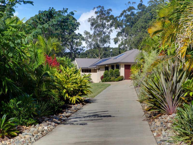 modern garden design using grass with verandah  u0026 hedging