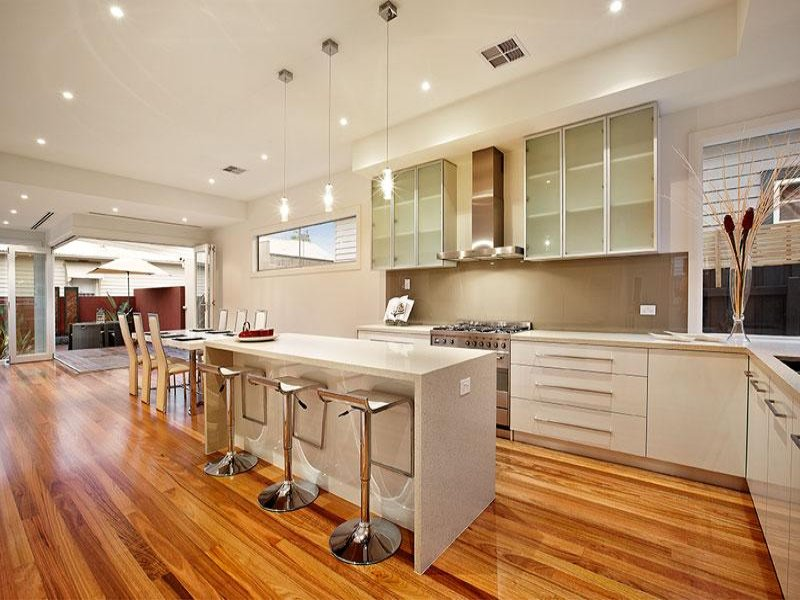Modern island kitchen design using floorboards kitchen for Kitchen reno design