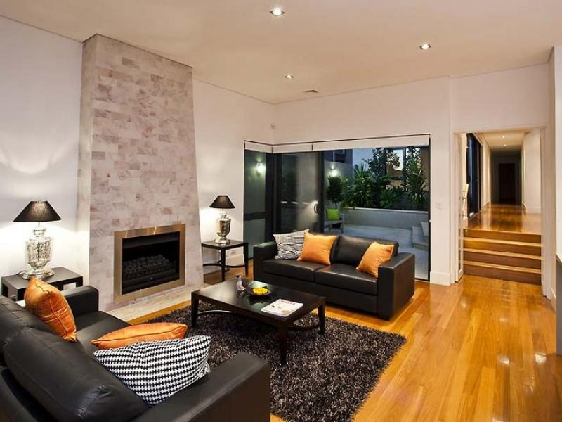 Open Plan Living Room Using Brown Colours With Carpet