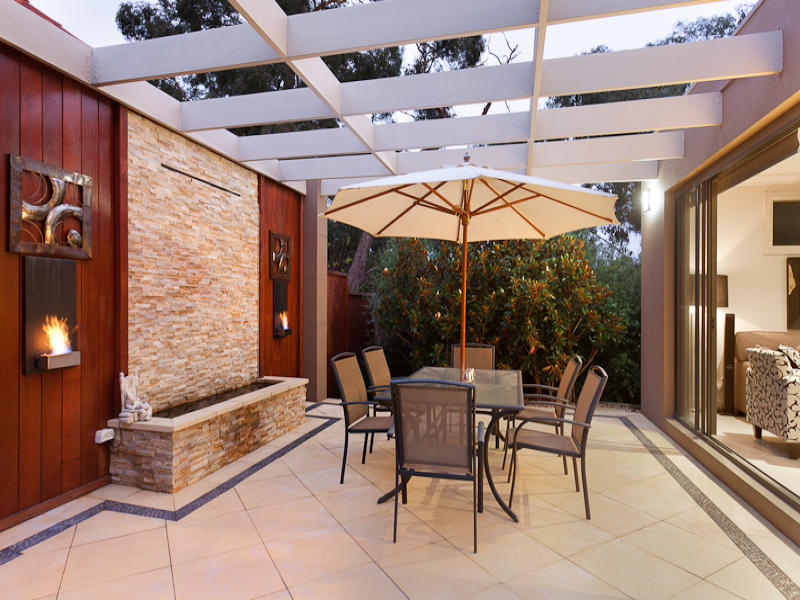 Walled Outdoor Living Design With Pergola Amp Decorative