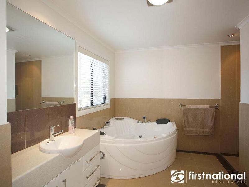 modern bathroom design with corner bath using ceramic bathroom photo