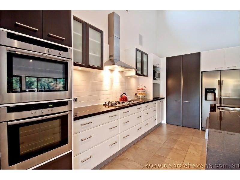 Modern galley kitchen design using granite kitchen photo for Single wall galley kitchen designs