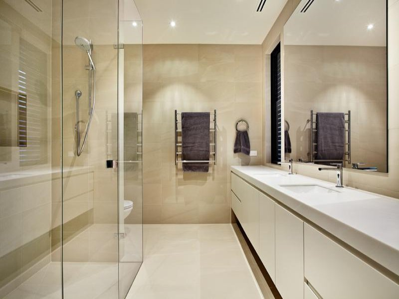 modern bathroom design with twin basins using glass